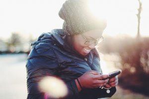 african girl using social media
